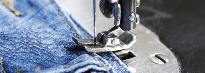 Dealing with tough fabric in making custom jeans.